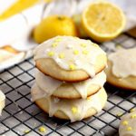 A stack of lemon ricotta cookies topped with lemon glaze and sprinkles.
