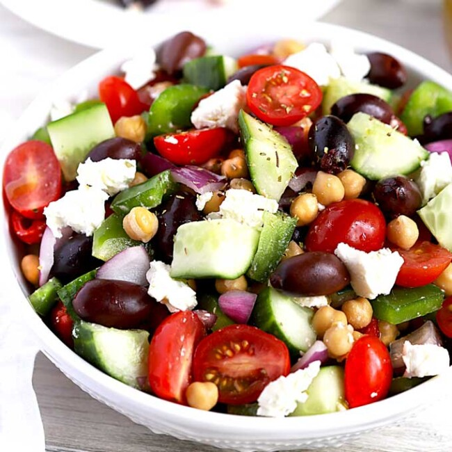 A white bowl filled with Mediterranean Garbanzo Bean Salad
