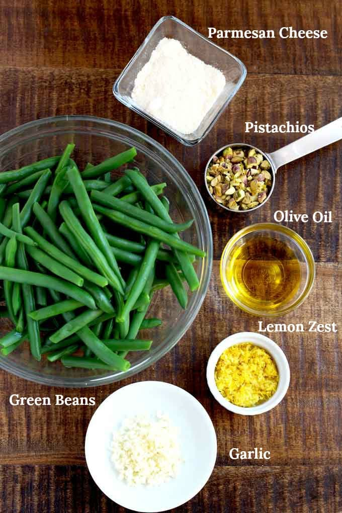 Ingredients to make Sauteed green beans on a wooden surface