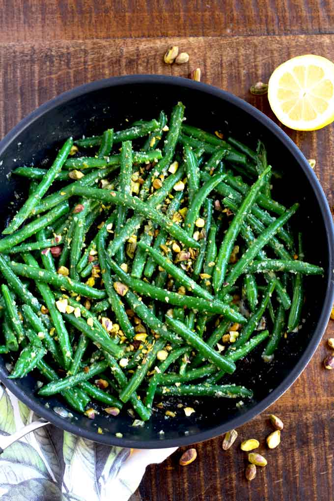 Overhead vied of Sauteed green beans in a skillet.