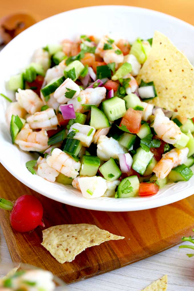 Big bowl of Mexican ceviche with tortilla chips.