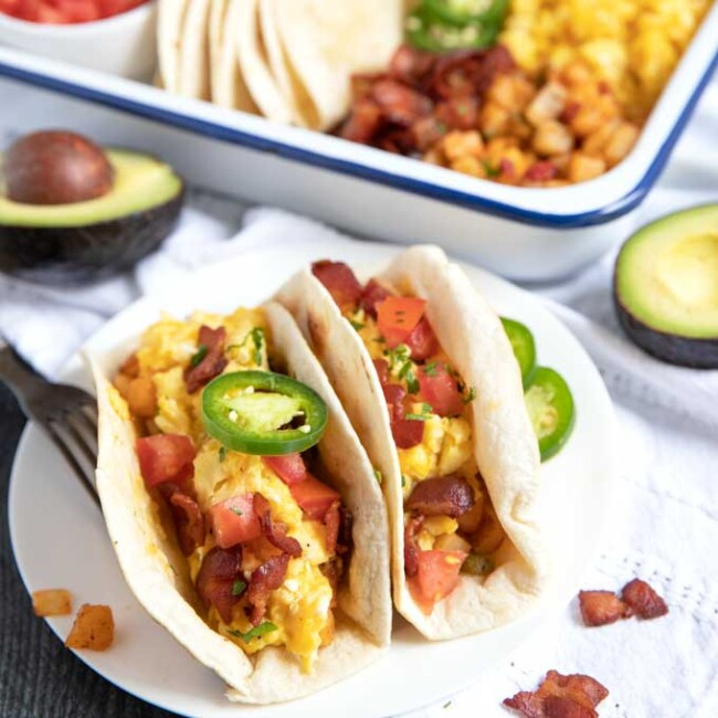 Breakfast tacos served on a white plate