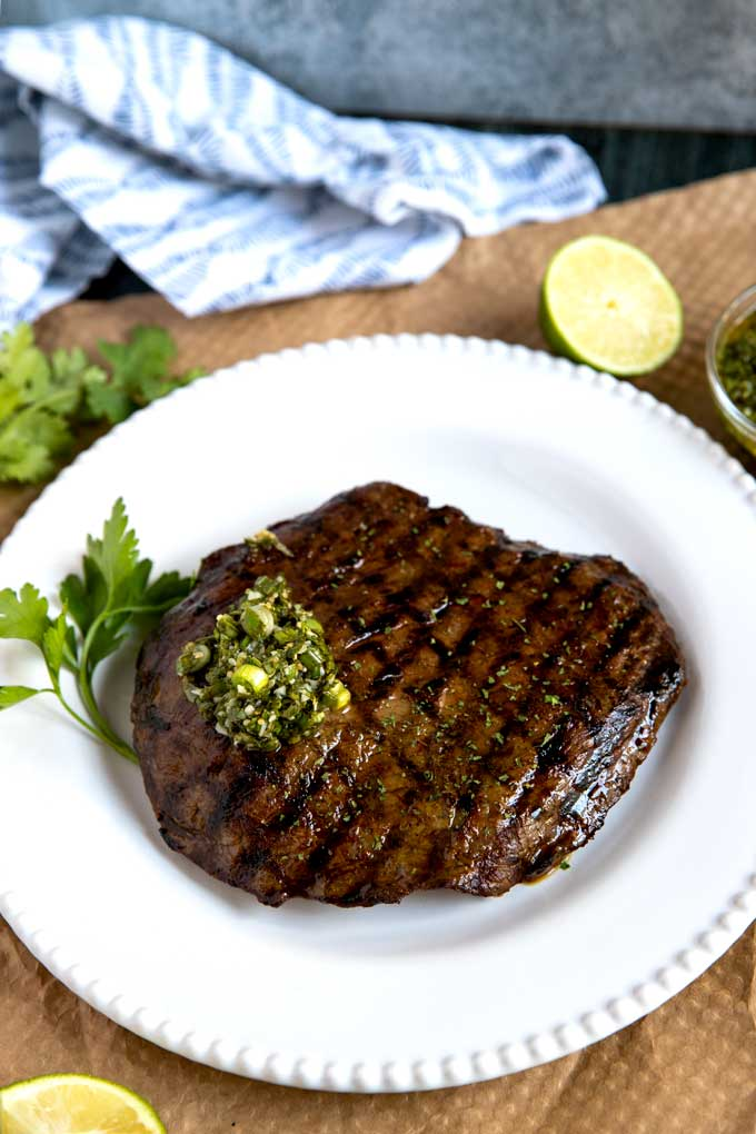 Sliced flank steak grilled and topped with Asian herb sauce.