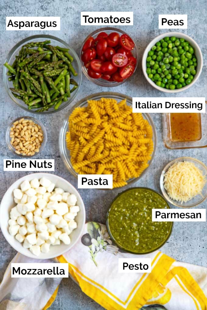 Ingredients for making this pasta salad recipe in small glass bowls.