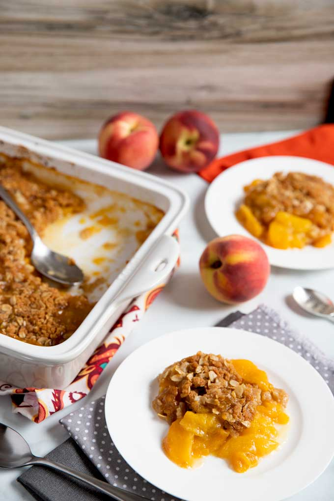 Fruit crisp in a baking dish and served on plates.