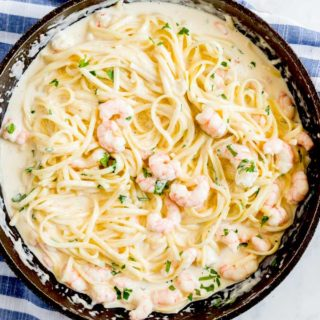 Parmesan pasta with shrimp in a skillet