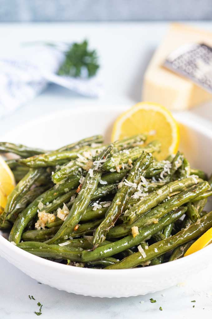 Roasted string beans in a white bowl