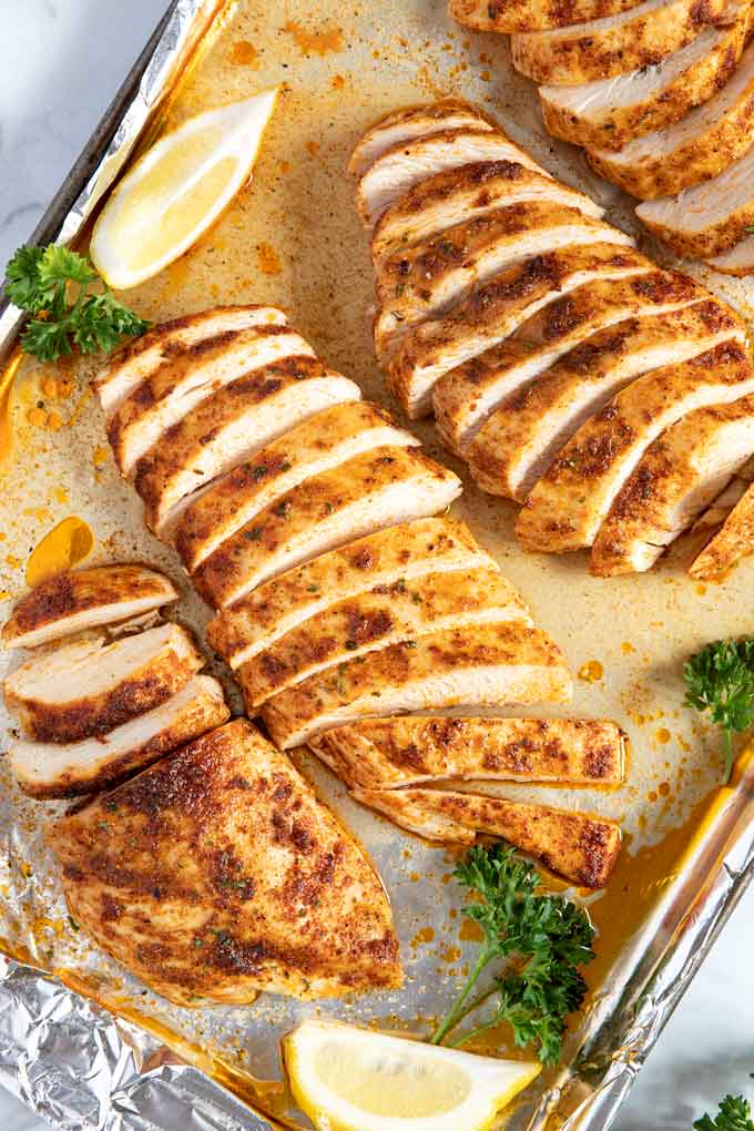 Baked Chicken breast sliced on a sheet pan