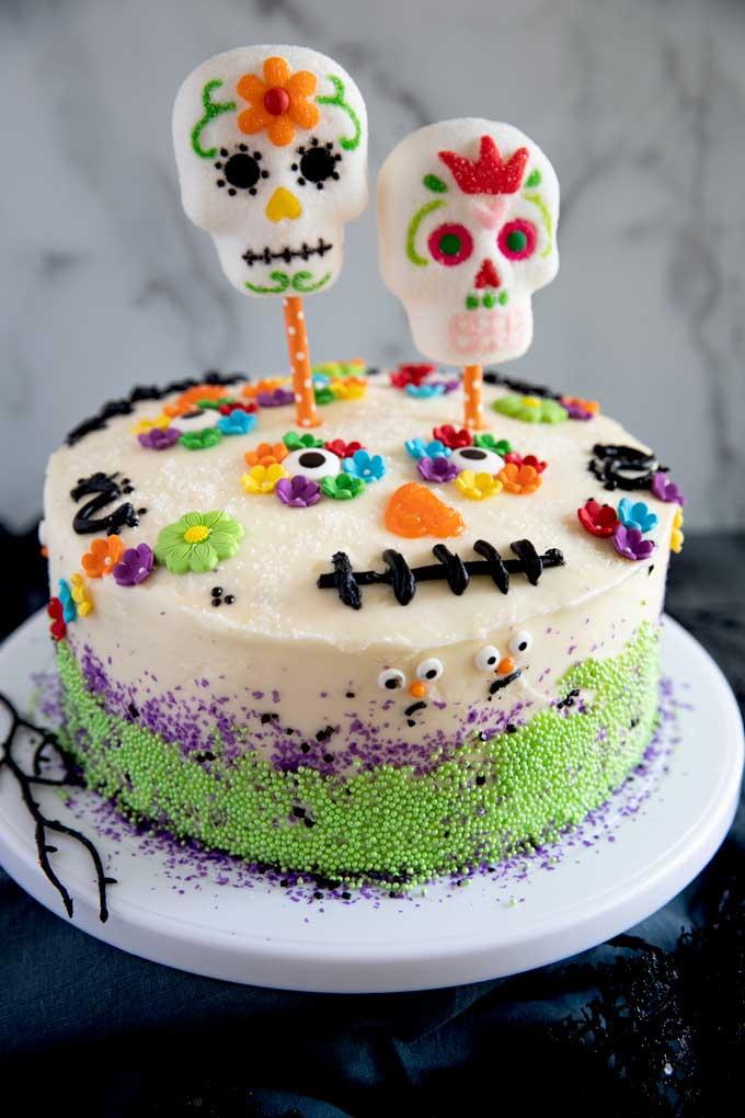 Dia de los Muertos Cake on white pedestal