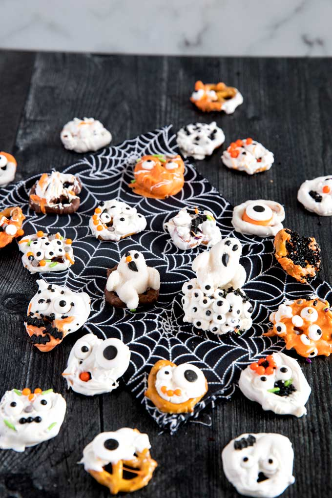 Halloween Pretzels on a dark surface.