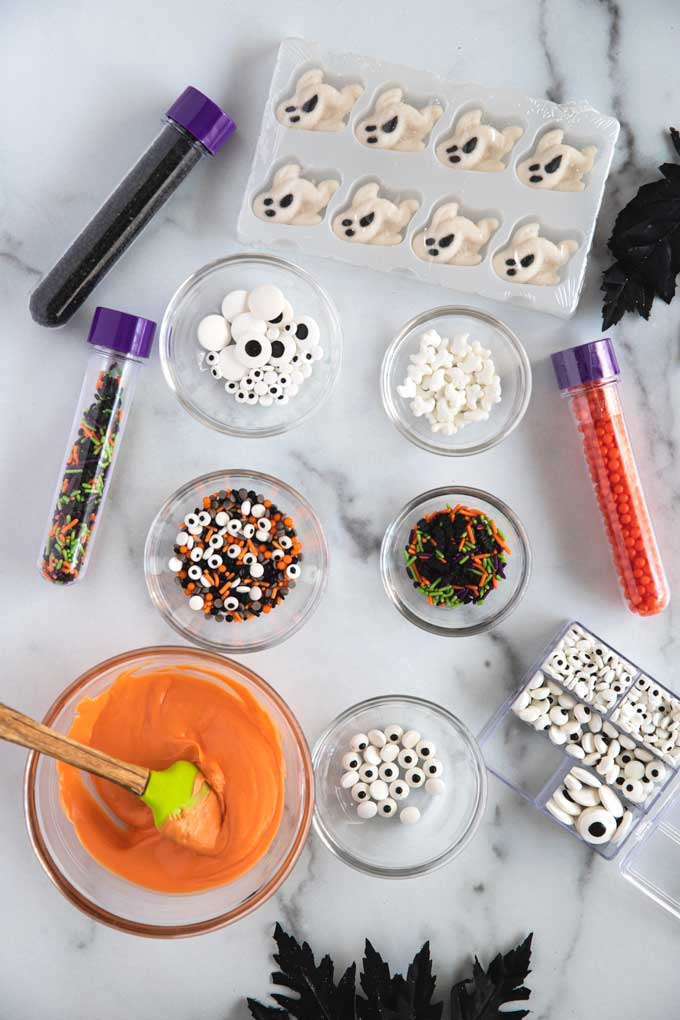 Table set up with ingredients to decorate the Halloween pretzels.