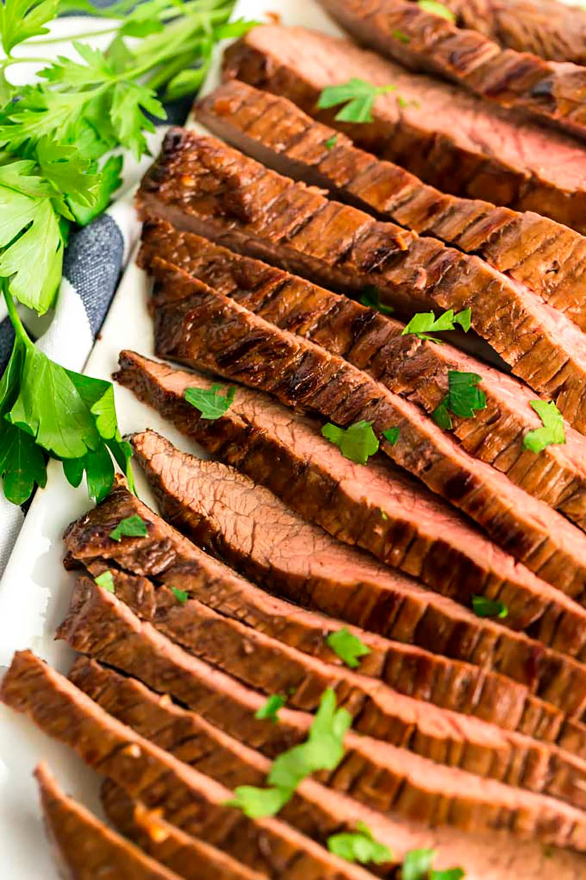 Close up of sliced flank steak on a plate