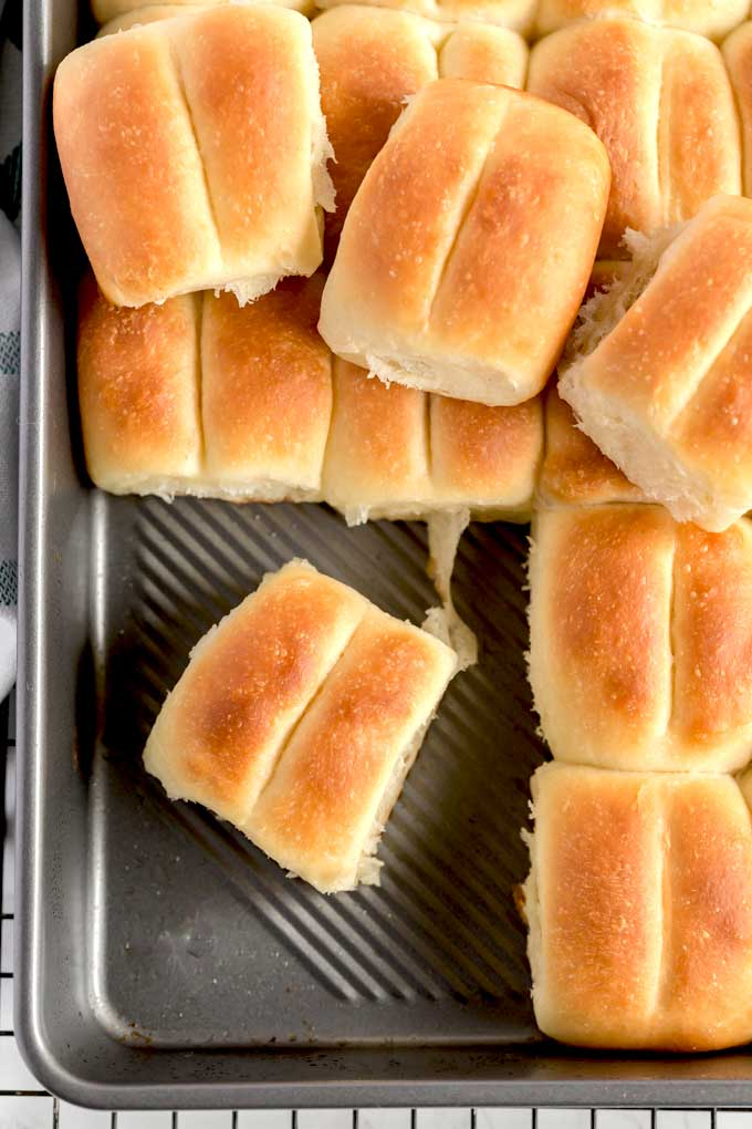 Top view of soft Parker House rolls on a baking pan