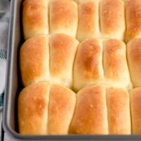 View of a baking dish filled with Parker House Rolls