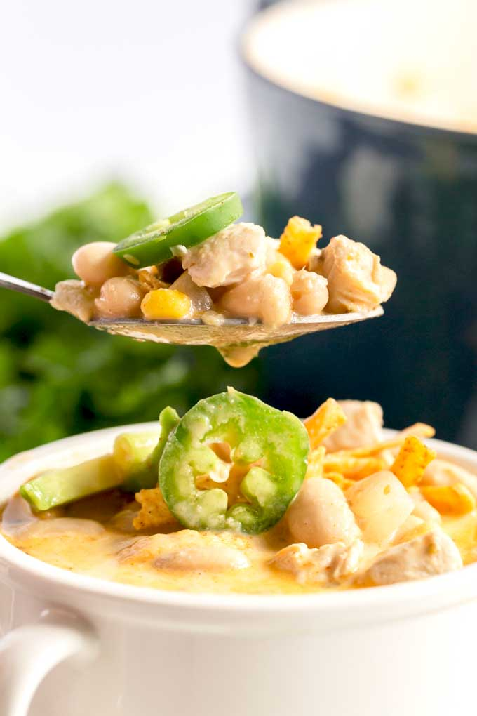 A spoon full of white bean chicken chili.
