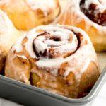 Close up to a cinnamon bun in a pan