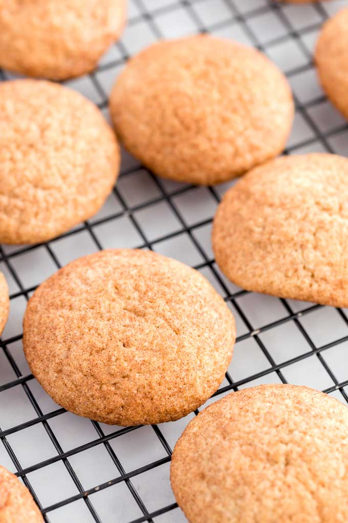 Cinnamon sugared covered cookies on a cooling rack.