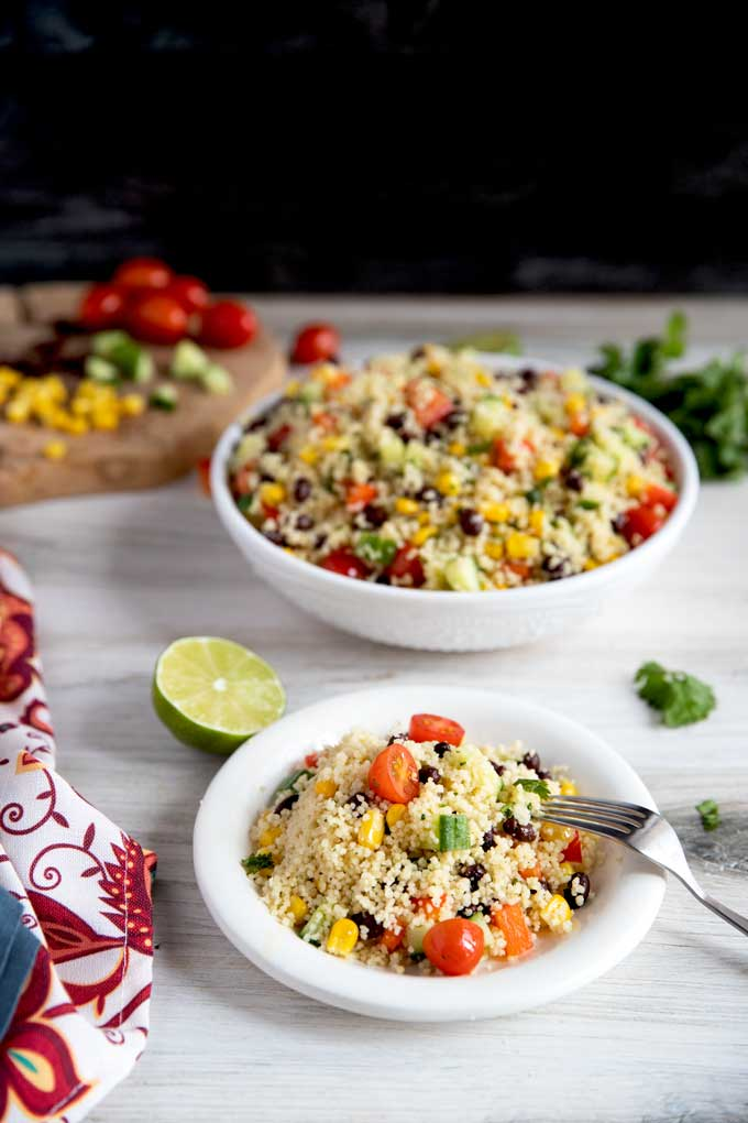 A bowl and a plate with Southwest Couscous Salad
