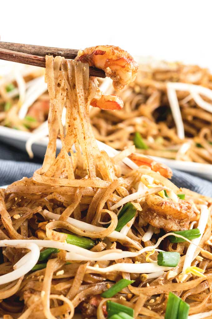 Pad Thai noodles lifted with chopsticks