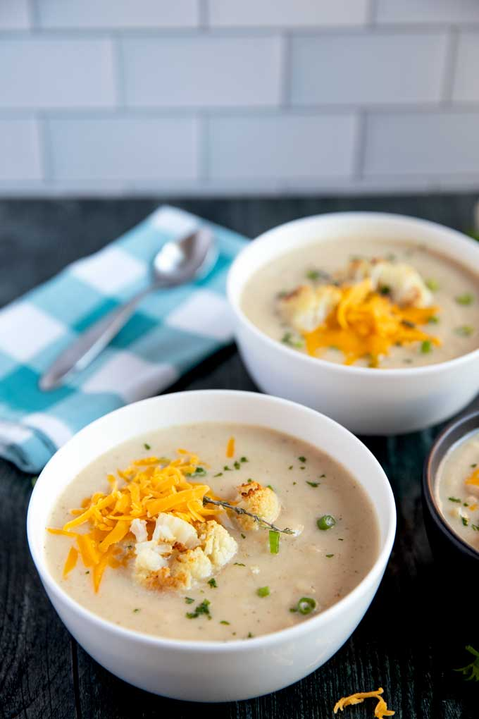 Roasted cauliflower soup in a white bowl