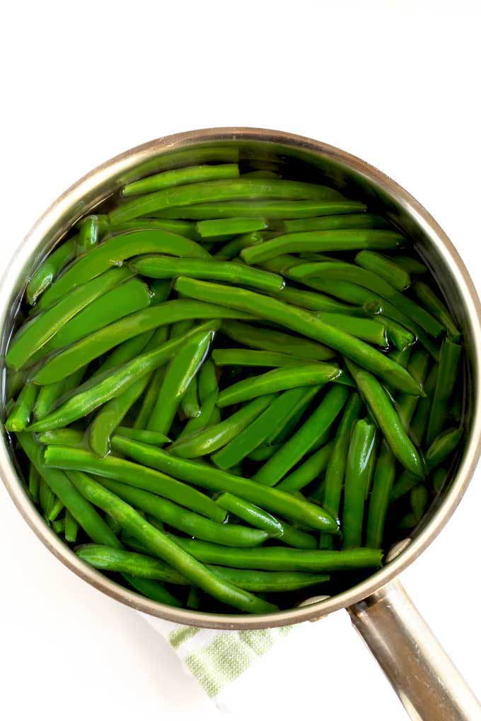 Blanched green beans or string beans in a pot of water
