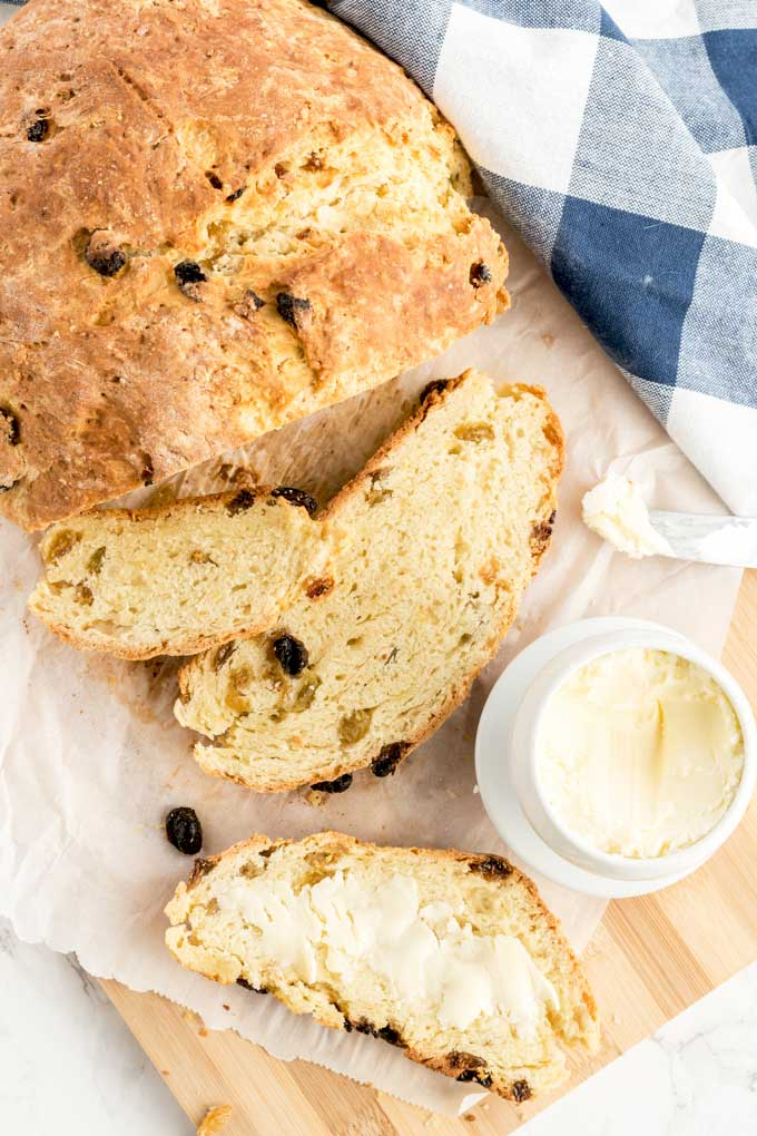 Slices of Irish Soda Bread slathered with butter