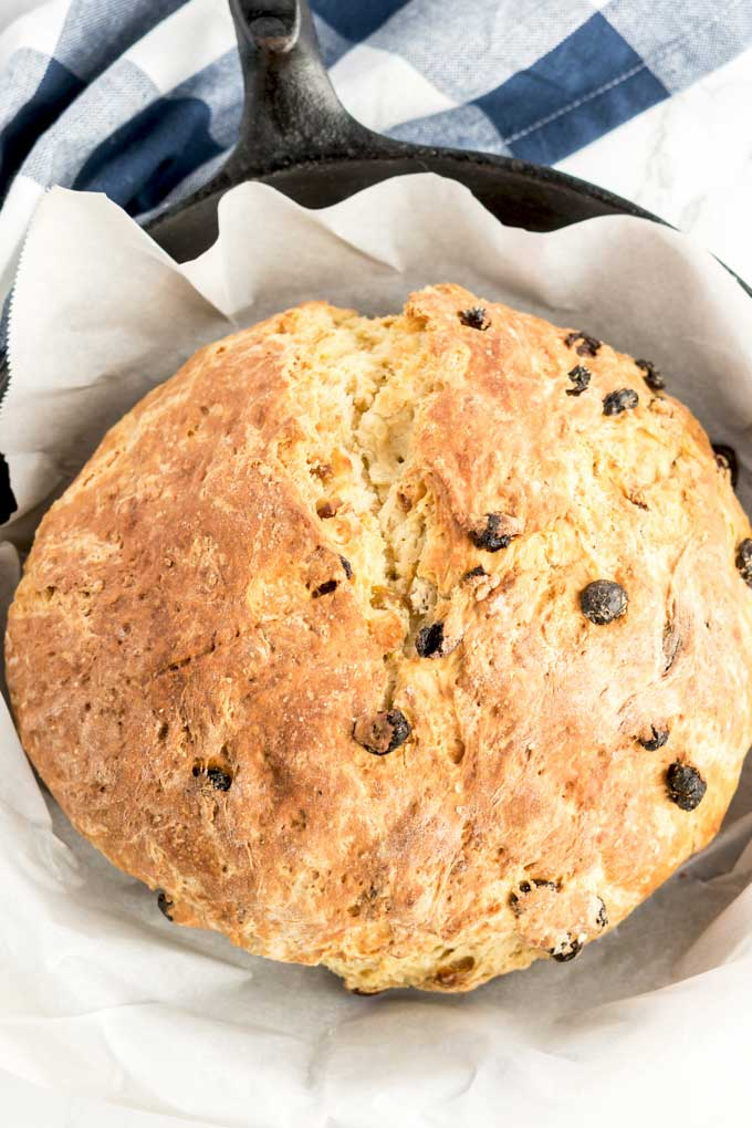 A loaf of Soda bread in a cast iron skillet.