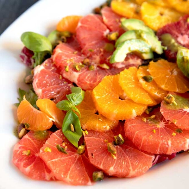 Citrus Salad with sliced grapefruit, oranges and avocado on a platter