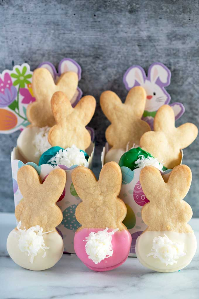 Cute and festive Easter Bunny Cookies made with shortbread cookies dipped in chocolate.