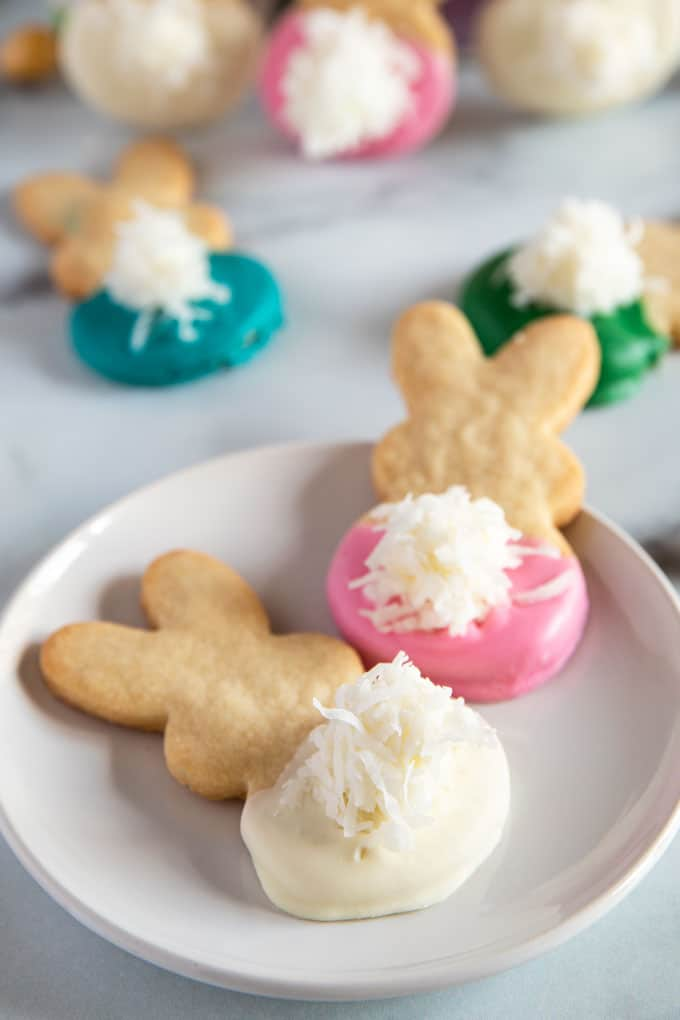 Easter Bunny Cookies with fluffy tails on a plate