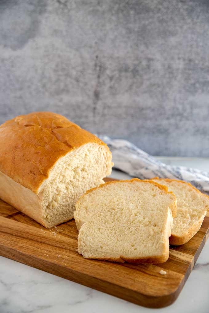 Homemade sandwich white bread sliced on a cutting board