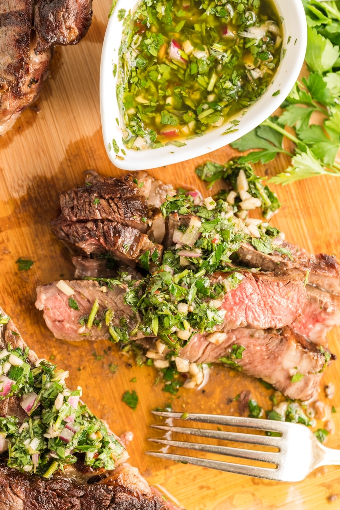Argentinian Chimichurri Sauce slathered on top of sliced grilled ribeye steak.
