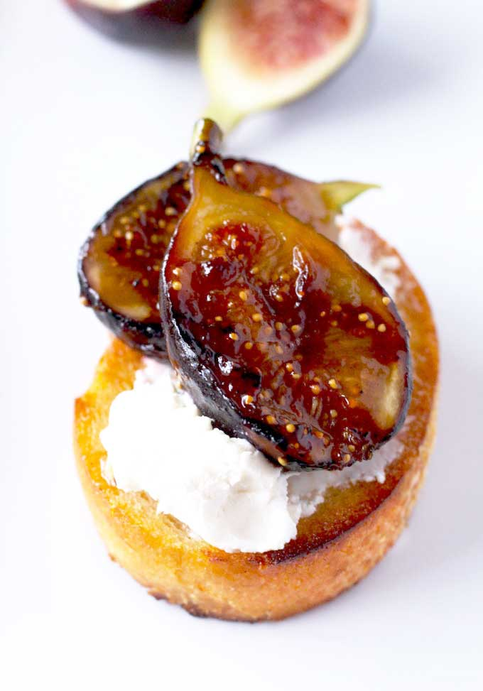 Crostini topped with creamy goat cheese and caramelized figs.