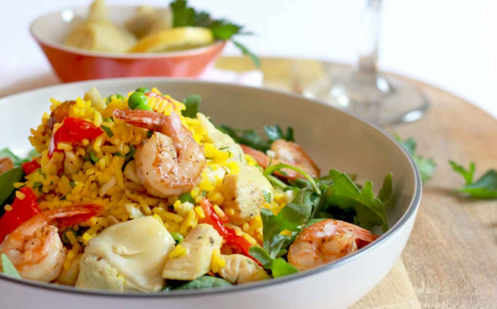 Easy to make Paella Salad with Shrimp and Chicken served on a bowl.