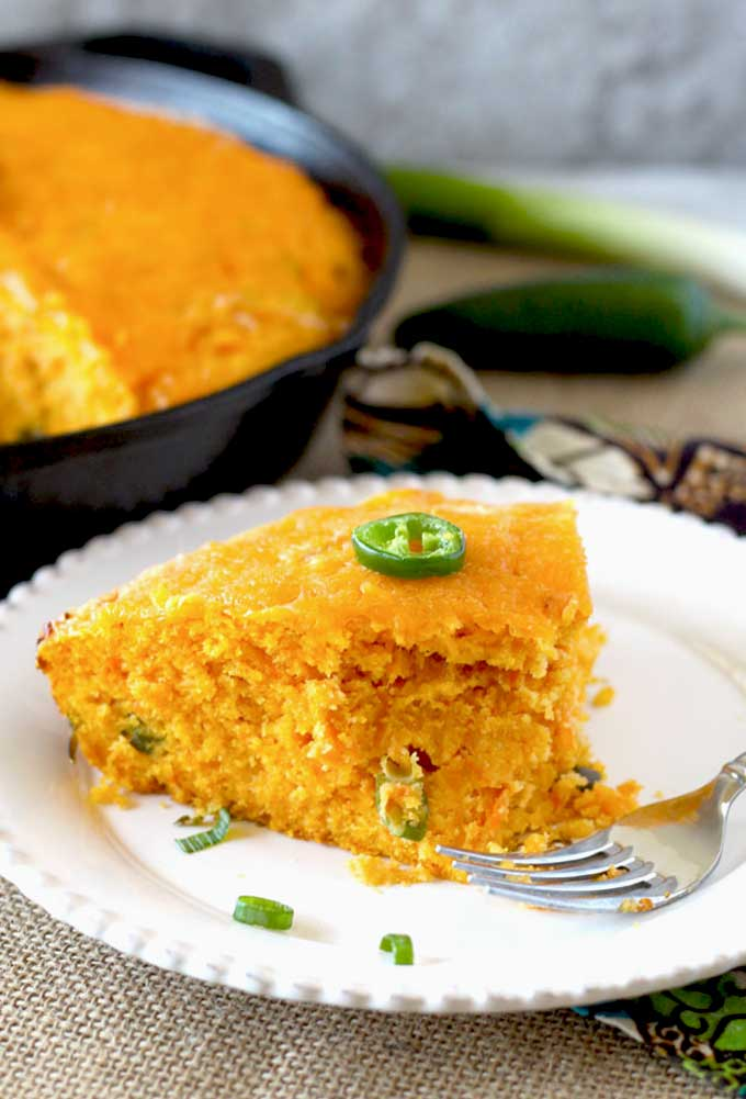 Skillet Sweet Potato Cornbread with Cheddar and Jalapeno served on a white plate.