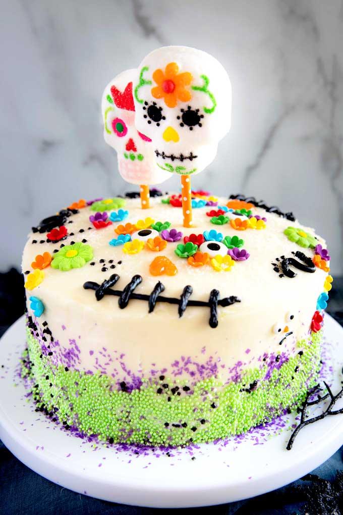 Diad De Los Muertos Cake with beautiful colorful sugar skulls and flowers
