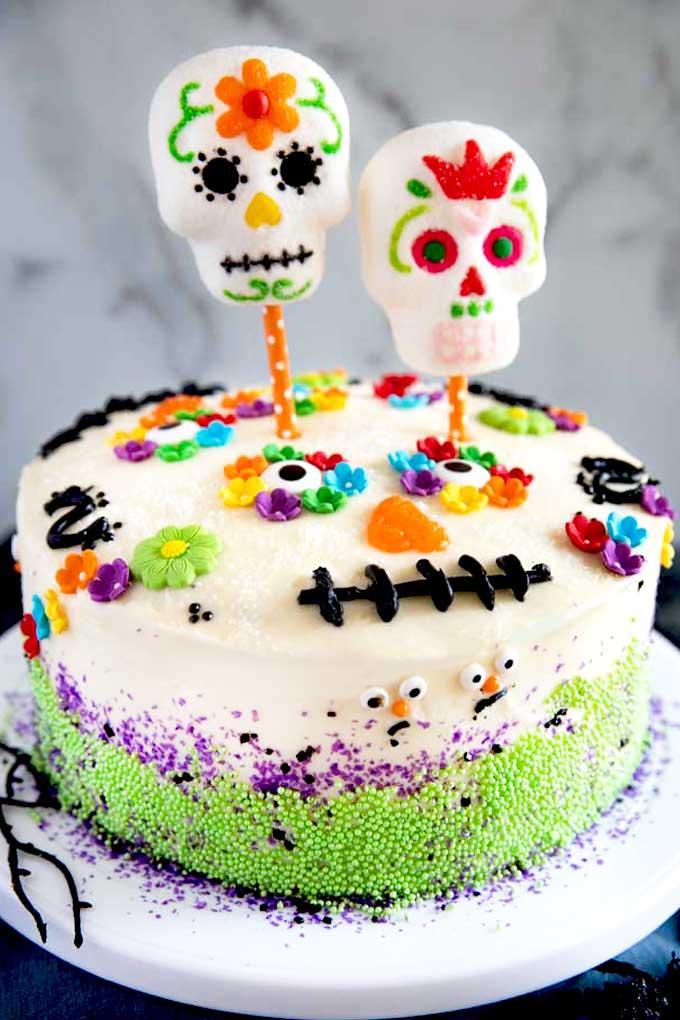 Dia De Los Muertos cake on a cake stand.