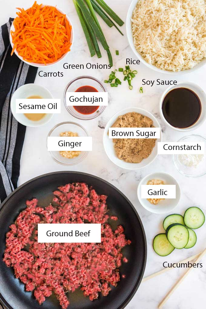 Ingredients for making Korean Beef Bowls on a light surface.