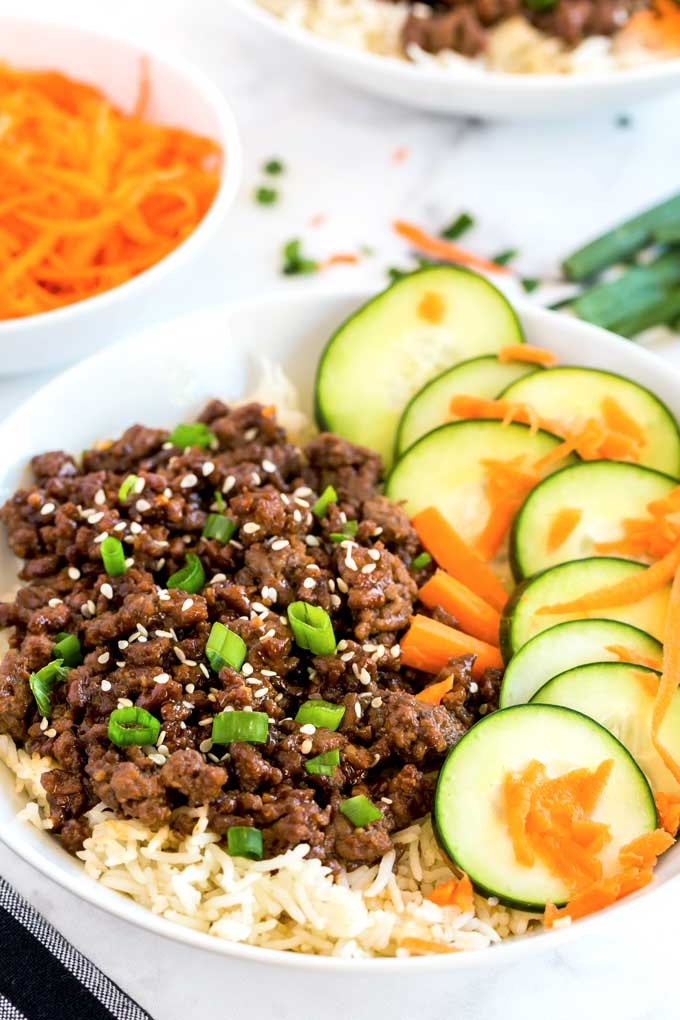 Korean Rice bowl with ground beef, carrots and cucumbers.