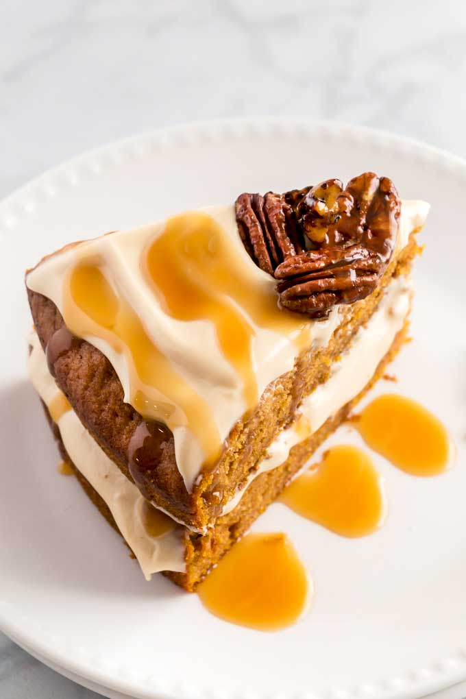 Top view of a slice of the best pumpkin cake with frosting and caramel drizzle.