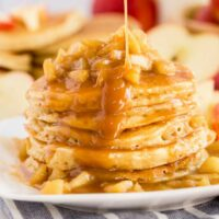 Stack of apple pancakes drizzled with caramel