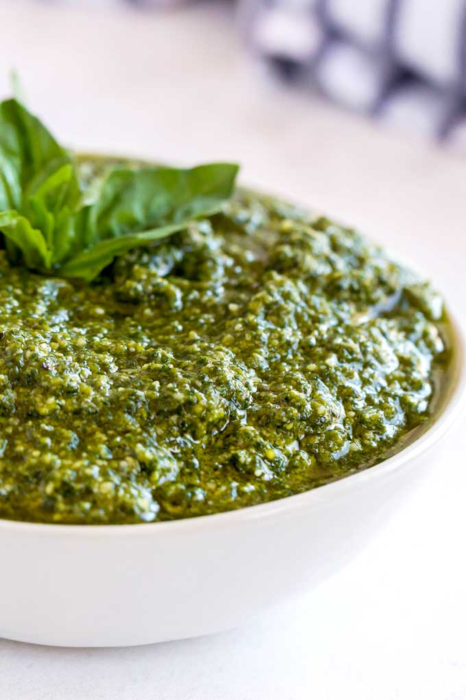 Close up of a white bowl filled with Italian pesto.