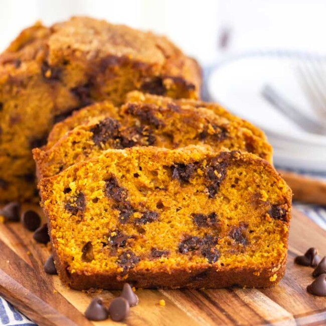 Chocolate chip pumpkin bread sliced on a cutting board.