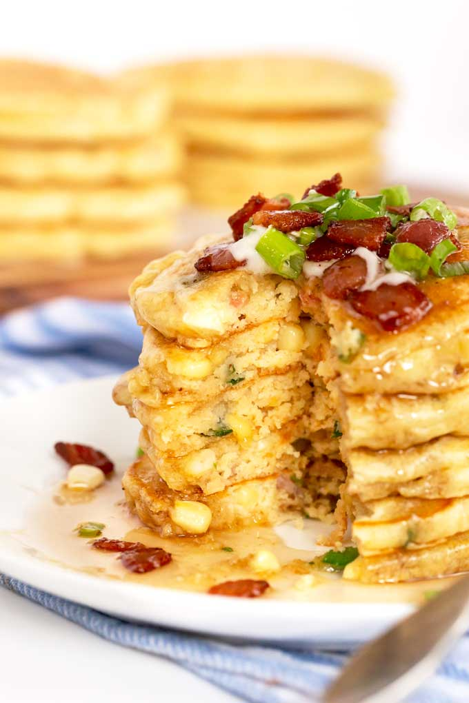Cut up pancakes on a stack showing the soft inside.