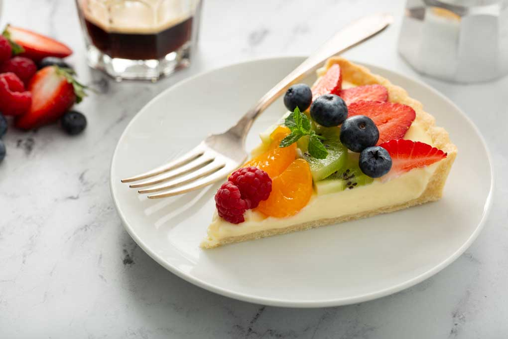 A slice of sweet tart on a white plate