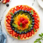 Top view of a French Tart on a white serving platter.