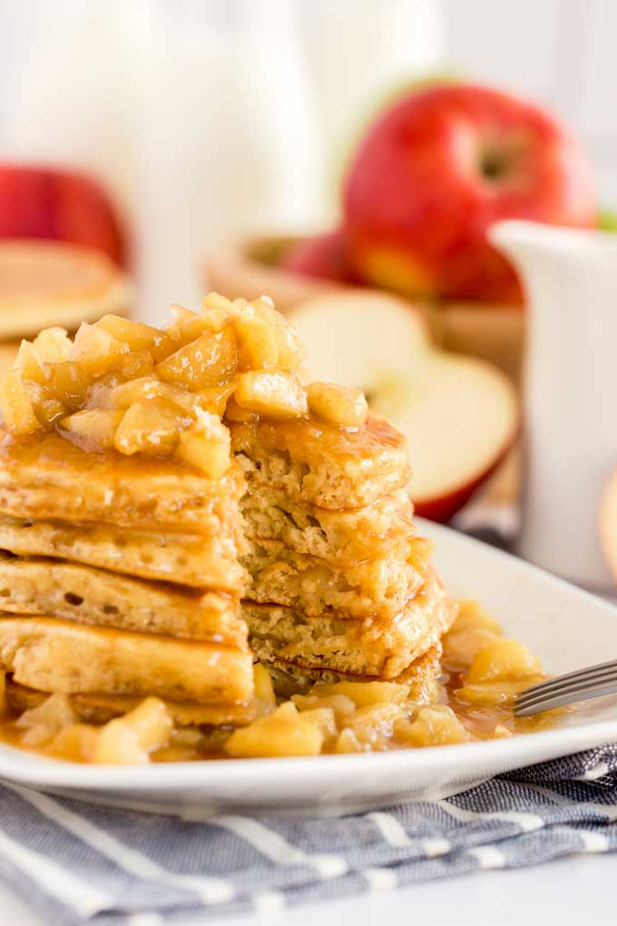 Pancakes with caramel apples on a white plate