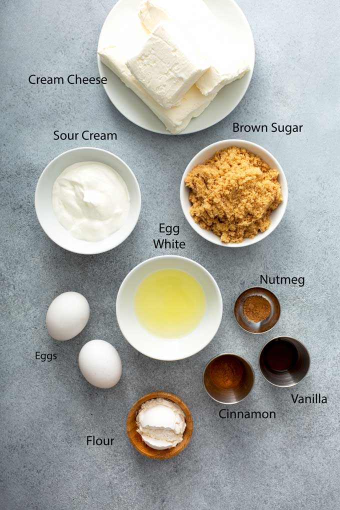 Ingredients to make the cream cheese filling on a gray surface.