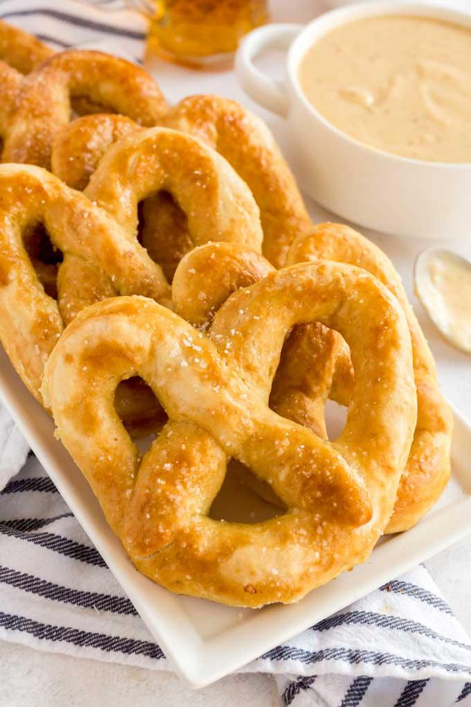 Baked pretzels on a white platter