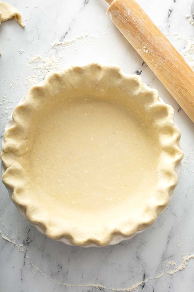 Unbaked pie crust on a pie plate